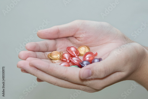 Fotografie, Obraz  Hand holding hair vitamin oil serum capsule beauty care
