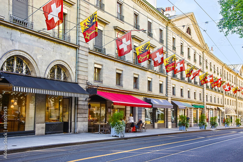 Fototapeta Geneva city street Rue Carraterie  view in summer with swiss flags on the street