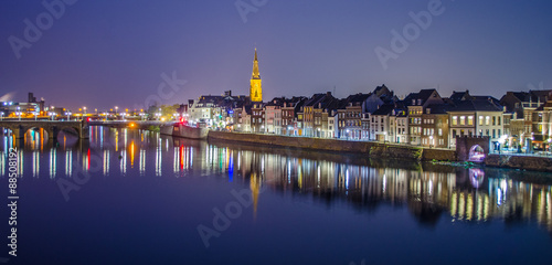 Night view over riverside of Meuse in Maastricht. Wallpaper Mural