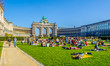 canvas print picture - People are relaxing next to cinquantenaire monument in brussels during first sunny weekend in March.