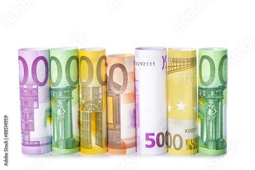 Fotografie, Obraz  Billetes de euro enrollados aislados sobre fondo blanco con espacio para texto y