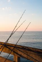 Three Fishing Poles Resting On...