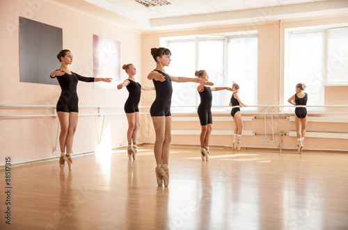Young dancers in ballet class плакат