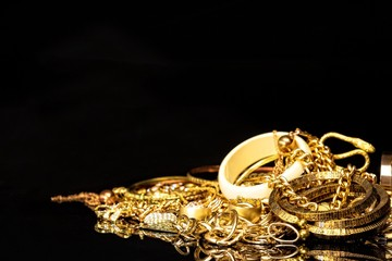Bunch of gold jewelry again...
