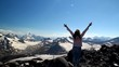 Winning success woman happy with his arms raised above his head in celebration of reaching the top of a mountain during a camping trip, the concept of freedom