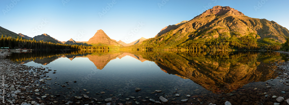 Fototapety, obrazy: Stunning reflections on Two Medicine Lake in northern Montana at sunrise
