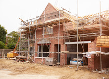 Building Site With House Under...