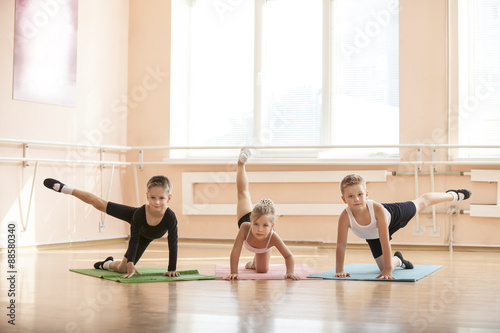 Fényképezés  Young dancers warming up at ballet class