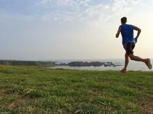 Runner On Grassy Cliff Top Tra...