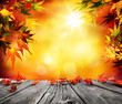 canvas print picture Autumn background with red falling leaves on wooden plank