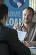 Caucasian male in a home loans office