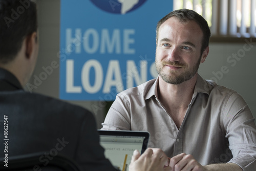 Fotografía  Caucasian male in a home loans office