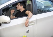 Man Tossing Litter From Open Car Window