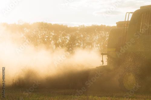 Staande foto Meloen Harvesting combine in the field