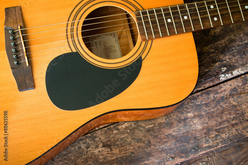 Photo Dreadnought acoustic guitar on a wooden background closeup