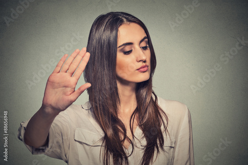 annoyed angry woman with bad attitude giving talk to hand gesture Fototapet
