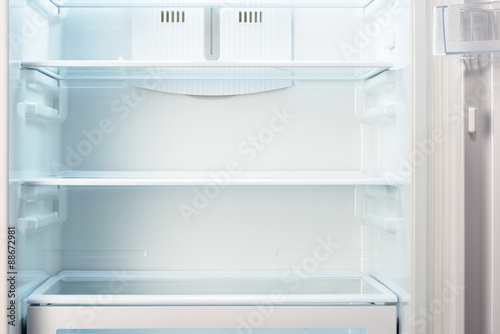 White open empty refrigerator. Weight loss diet concept.