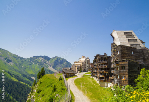 Fotografia, Obraz  Strange wooden  buildings in  Avoriaz , French mountain resort, in the middle of the Porte du Soleil , Alps Mountains