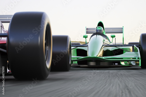 Fotografia, Obraz Motor sports race car competitive close quarters racing on a track with motion b
