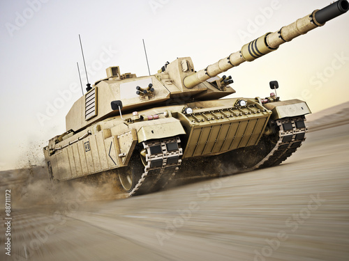 Obraz na plátně  Military armored tank moving at a high rate of speed with motion blur over sand
