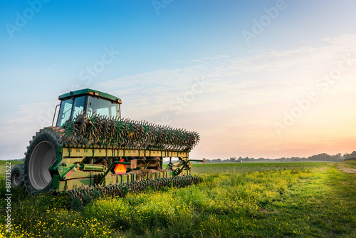 Tractor in a field on a rural Maryland farm плакат