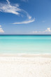 Shore of classic turquoise Caribbean Sea dream beach under bright blue sky near the resort town of Varadero, Cuba