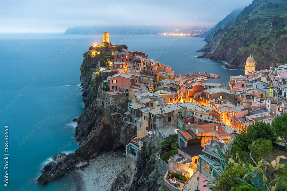 Illuminated at night the town on the rocks Liguria Italy