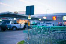 Row Of Shopping Carts At Entrance Of Supermarket Near Parking Lo