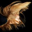 canvas print picture - Frau mit langen blonden fliegenden Haaren