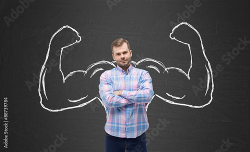 Young handsome man in casual shirt with drawn powerful hands Wallpaper Mural