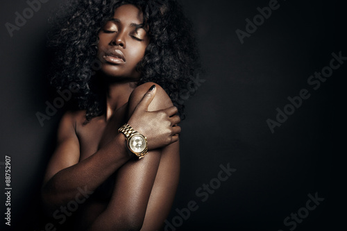 nude black woman with a watch плакат