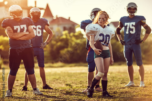 American football woman player in action on the stadium