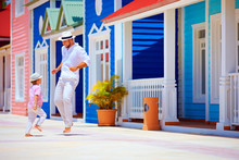 Happy Father And Son Enjoy Life, Dancing On Caribbean Village Street