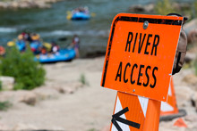 River Access Sign Pointing Dow...