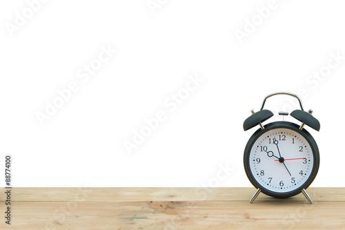 Alarm clock isolated on wooden floor