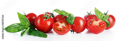 Poster Légumes frais Cherry tomatoes with basil isolated on white