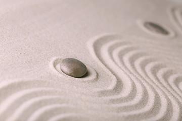 Fototapeta na wymiar Zen garden with stones on sand background