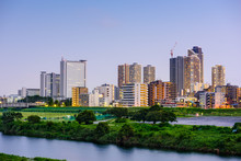 Kawasaki, Japan Skyline At The Tamagawa River.