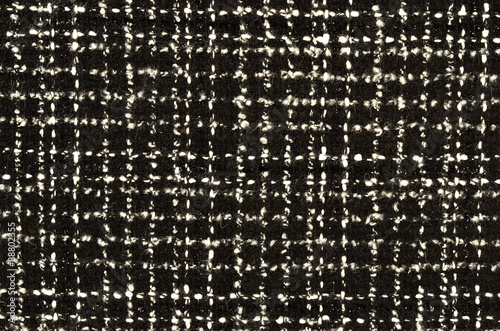 Photo  Black and white wool twill pattern. Woven design as background.