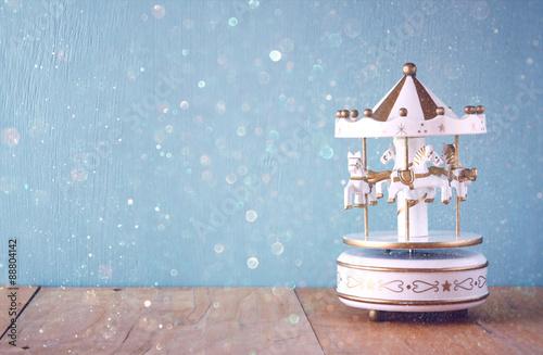 Fotografie, Obraz  old vintage white carousel horses on wooden table. retro filtered