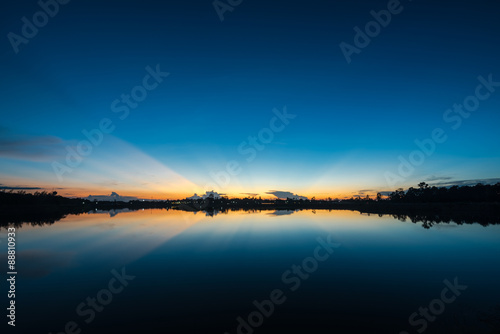 Foto op Aluminium Nachtblauw Sunset landscape with blue sky at the calm lake
