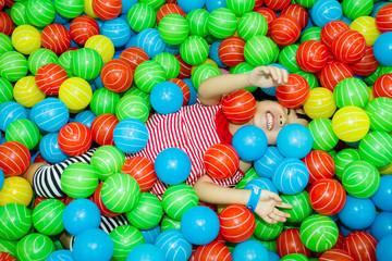 Fototapeta na wymiar Asian Chinese Girl In Ball Pool