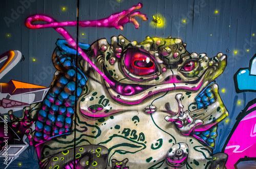 Leinwand Poster Graffiti: Frosch bei der Jagd