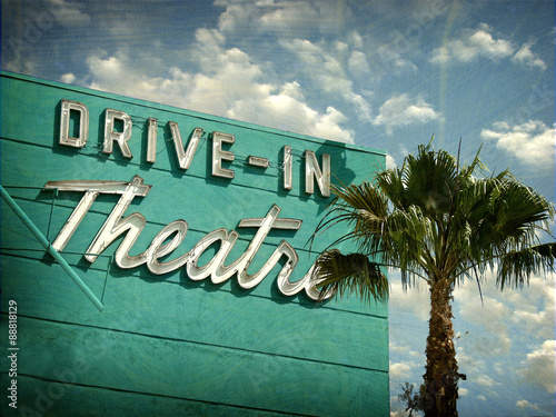 Photo  aged and worn vintage photo of drive in theater