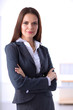 Portrait of business woman standing with crossed arms in office