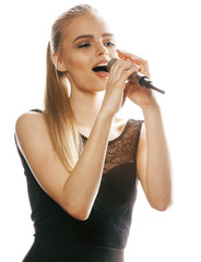 Fototapeta young pretty blond woman singing in microphone isolated