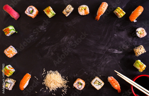 Tuinposter Sushi bar Sushi set on dark background. Minimalism