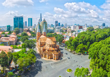 Ho Chi Minh City Is A Sunny Day Underneath Notre Dame Buildings Over A Hundred Years Old, So Far Is The High-rise Buildings For The Economic Development Of Vietnam Today