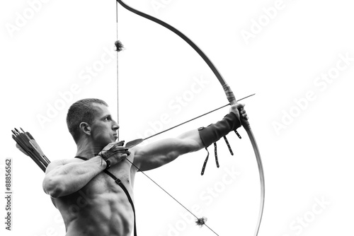 Archery. Young archer training with the bow Fototapeta
