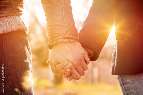 Fotografering  Couple holding hands